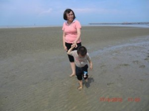 Caleb and his mother at the beach